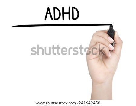 Hand with pen writing ADHD on whiteboard - stock photo