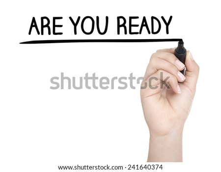 Hand with pen writing ARE YOU READY on whiteboard - stock photo