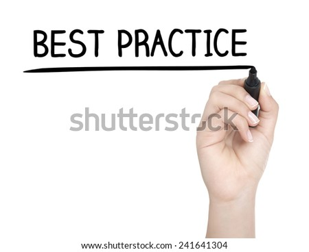 Hand with pen writing BEST PRACTICE on whiteboard - stock photo