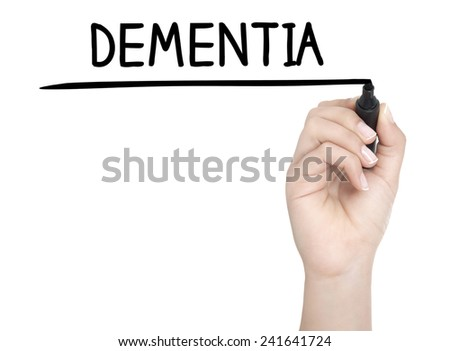 Hand with pen writing DEMENTIA on whiteboard - stock photo