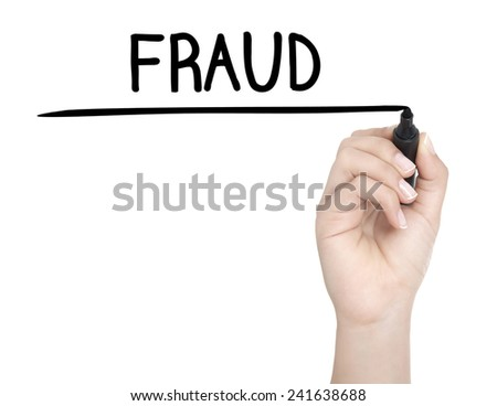 Hand with pen writing FRAUD on whiteboard - stock photo