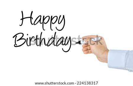 Hand with pen writing Happy Birthday