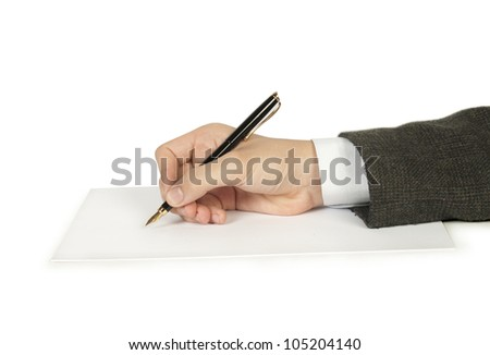 hand with pen writing on the page