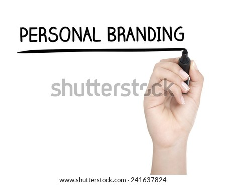 Hand with pen writing PERSONAL BRANDING on whiteboard - stock photo
