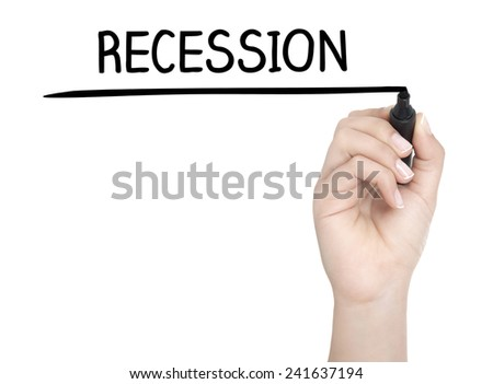 Hand with pen writing RECESSION on whiteboard - stock photo