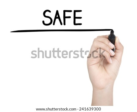Hand with pen writing SAFE on whiteboard - stock photo