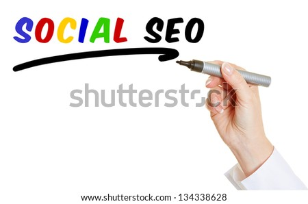Hand with pen writing Social SEO into the air - stock photo