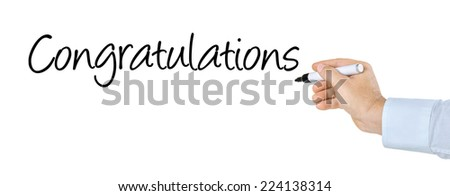 Hand with pen writing the word Congratulations - stock photo