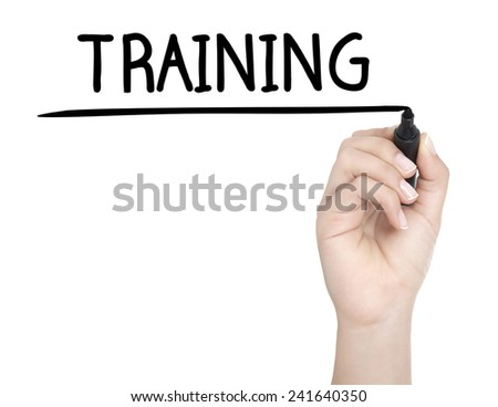 Hand with pen writing TRAINING on whiteboard - stock photo
