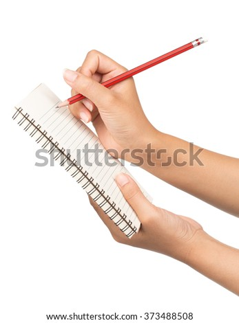 Hand with pencil writing in open notebook isolated on white background