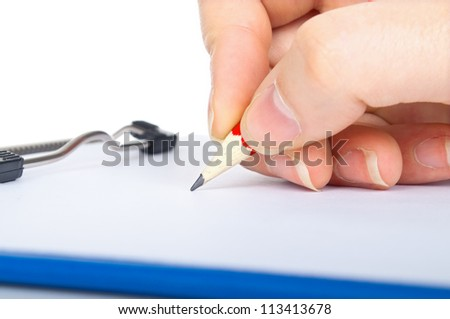 hand with pencil writing on clipboard isolated on white background - stock photo