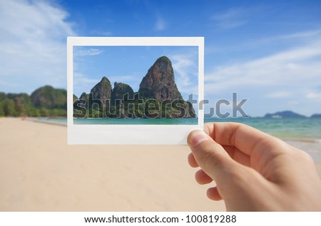 Hand With Photo of Beach. - stock photo