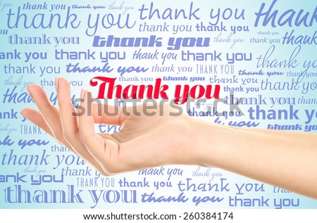Hand with phrase Thank You on color background - stock photo