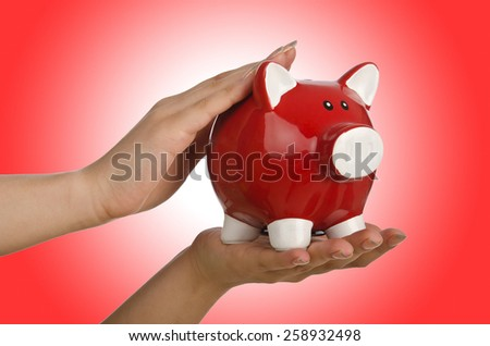 Hand with piggybank on white background - stock photo