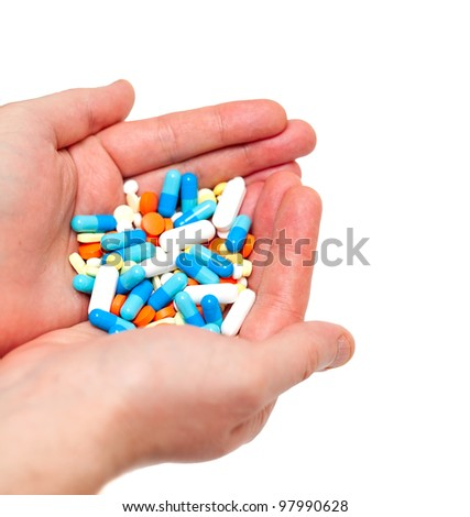 hand with pills - stock photo