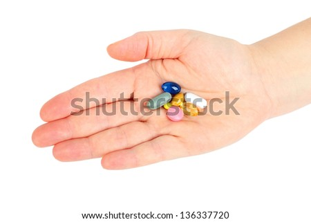 Hand with pills on white background