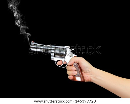 Hand with pistol - stock photo