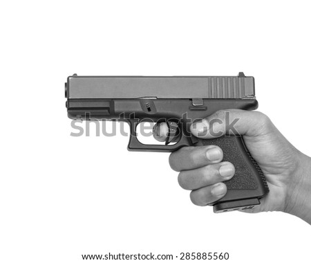 Hand with pistol isolated black and white tone on white background - stock photo