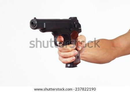 Hand with pistol on a white background - stock photo