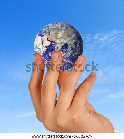 Hand with planet earth