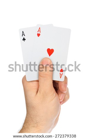 Hand with playing cards isolated on white background - stock photo