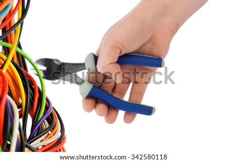 Hand with pliers and cable isolated on white background - stock photo
