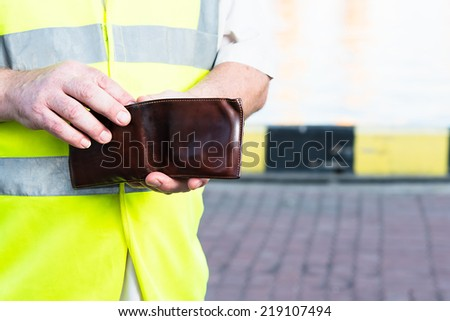 hand with purse - stock photo