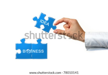 Hand with puzzle and words isolated on white - stock photo