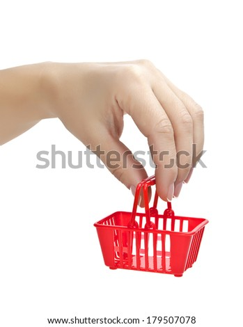 Hand with red grocery cart - stock photo