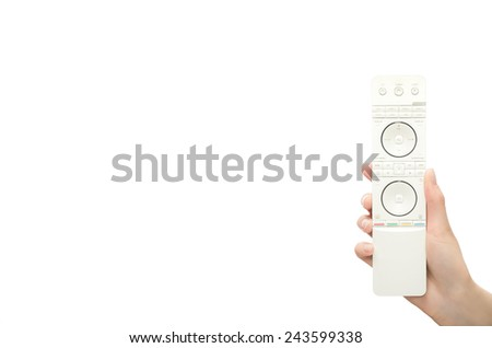 Hand with remote control. Isolated on white background. - stock photo