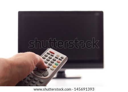 Hand with remote control over the TV set off