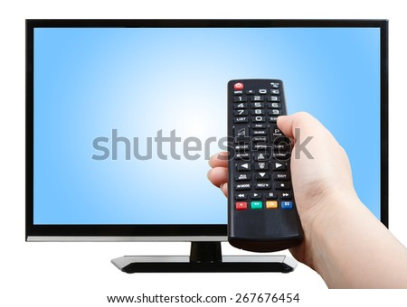 Hand with remote control pointing at modern plasma TV set - stock photo