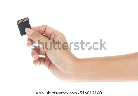 hand with sd card isolated on white