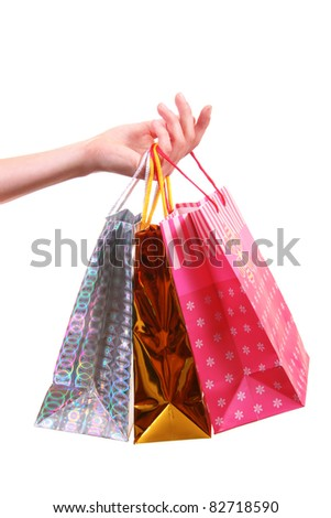 hand with shopping bags - stock photo