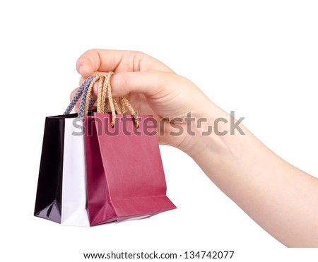 Hand with shopping bags isolated on white background.