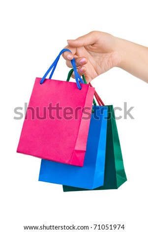 Hand with shopping bags isolated on white background