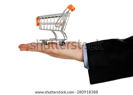 hand with shopping cart isolated on white - stock photo