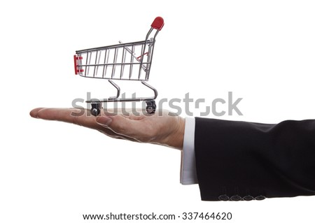 Hand with shopping cart isolated over white background - stock photo