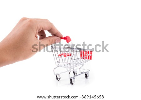 hand with shopping cart on white background - stock photo