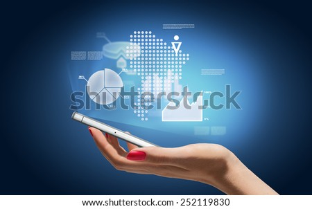 Hand with smartphone and business icons and graphic - stock photo
