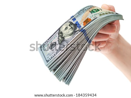 Hand with stack of one hundred dollar bills isolated on white background - stock photo
