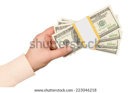 Hand with stacks of one hundred dollars banknotes - stock photo