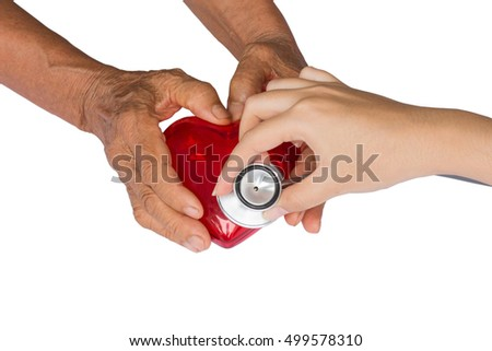 Hand with stethoscope examining red heart , isolated on white background