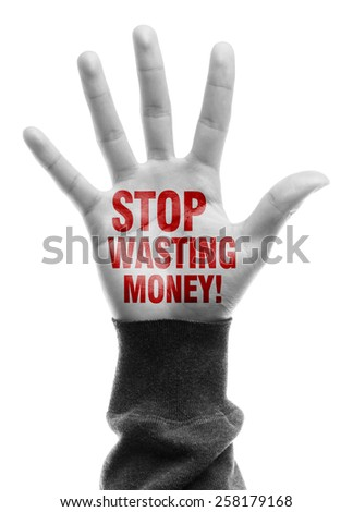 Hand with Stop Wasting Money text is isolated on white background. - stock photo
