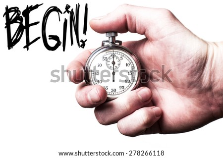 Hand with stopwatch commands you to start now - stock photo