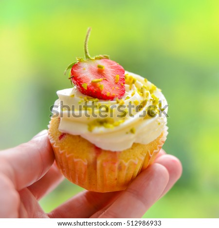 Hand with Strawberry Cupcake