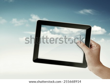 Hand with tablet  in sky