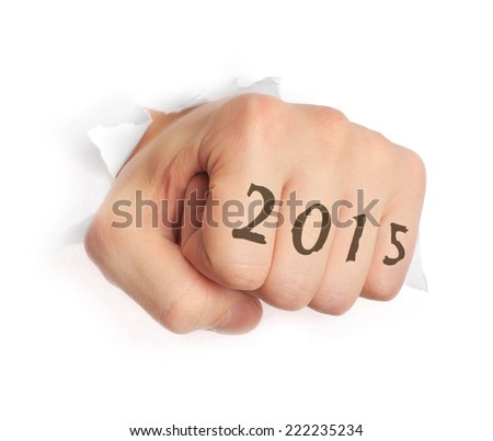Hand with 2015 tattoo punching through paper isolated on white - stock photo