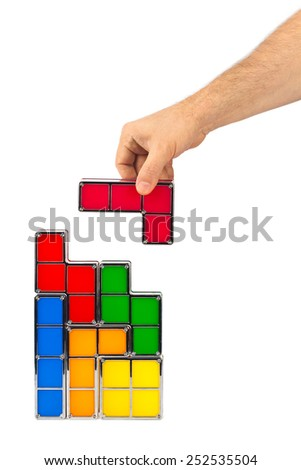 Hand with tetris toy blocks isolated on white background - stock photo