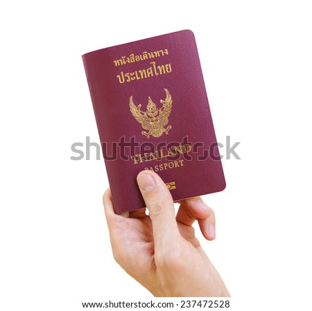 Hand with thai passport - stock photo